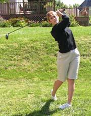 Nora plays golf